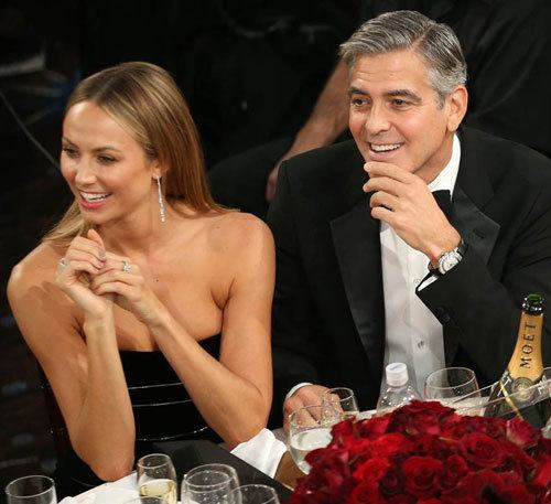 george clooney drinking champagne