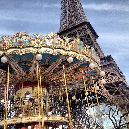 carousel under Eiffel towr. Instagram travel photo by @skimbaco