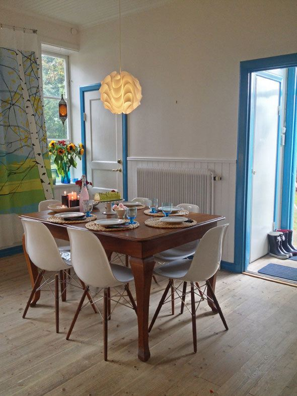 Scandinavian kitchen with Eames chairs