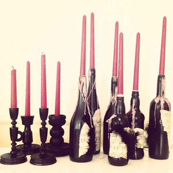 painted wine bottle candle holders | More Haunted House Party photos at https://www.skimbacolifestyle.com/2013/10/haunted-house-halloween-party-photos.html