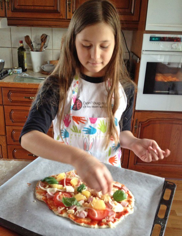 Gabriella making pizza on our regular make-your-own-pizza night.