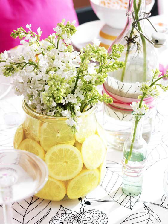 decorate with fruits: lemons in a flower vase