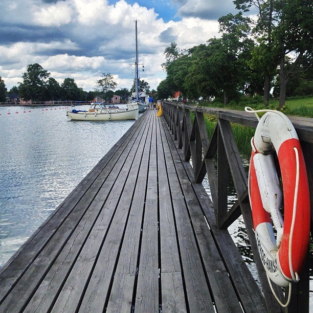 boats in a dock Vadstena | Instagram travel photo by skimbaco http://instagram.com/skimbaco