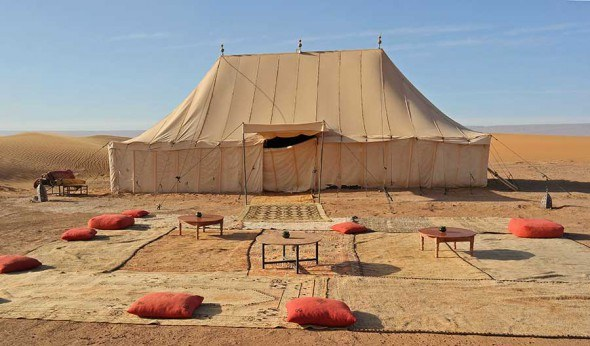 The restaurant tent at the Erg Chegaga Luxury Desert Camp in Sahara desert, Morocco