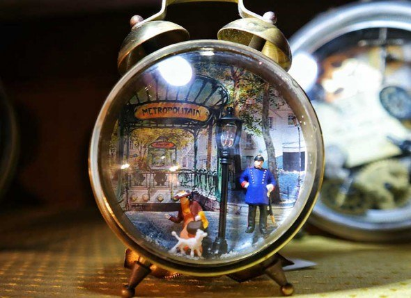 I loved these vintage clocks made into souvenir art.