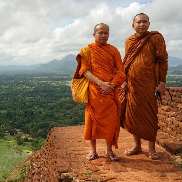 sri lanka monks at sigiriya rock