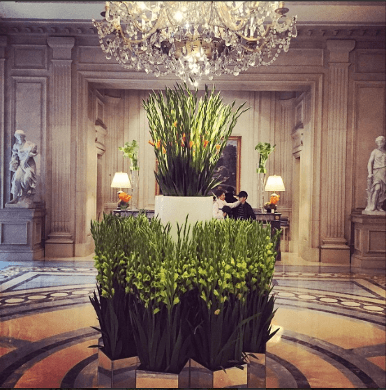 Hotel George V, on Avenue George V just off of Avenue Montaigne. The lobby of this Four Seasons property is always beautifully adorned with fresh flowers daily, and the garden is a posh, serene spot to grab an aperitif.