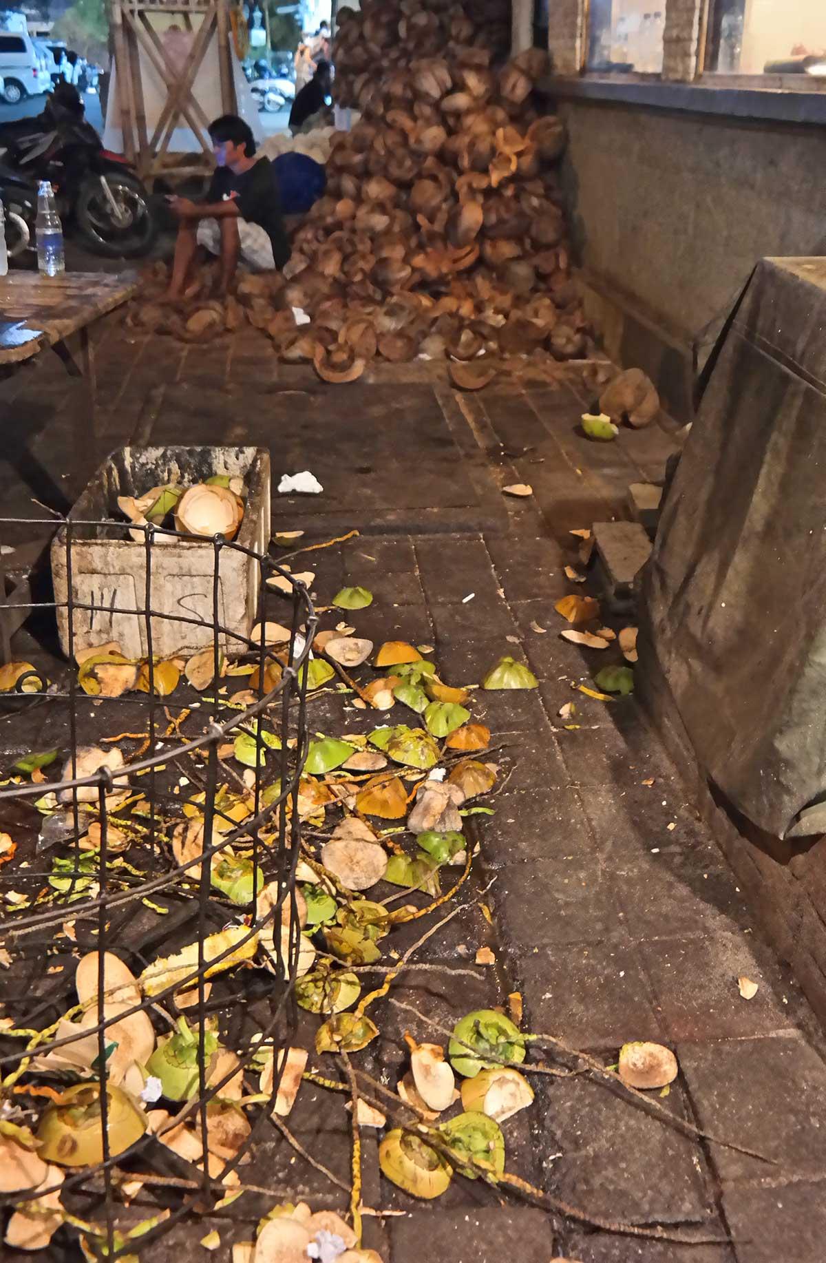coconut shells on the street in Jimbaran, Bali