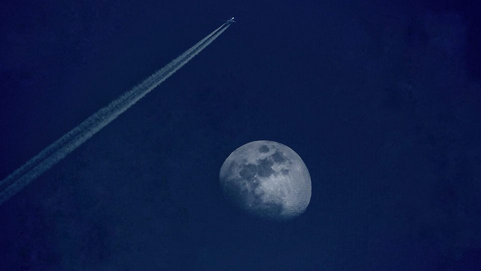 plane and moon. Photo by Kristian Presnal.