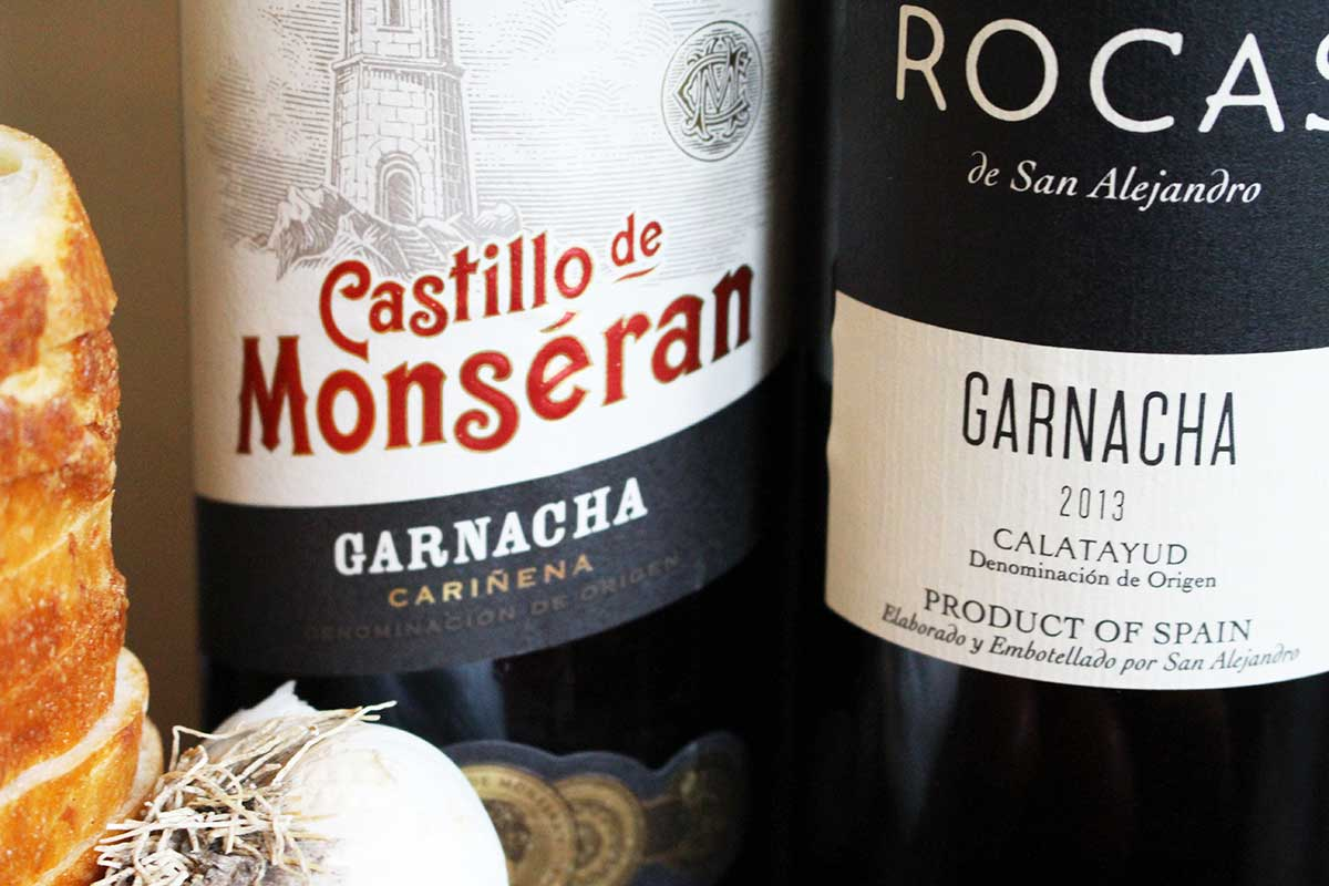 Learn about Garnacha, where to find it in Spain, our first impressions of Garnacha wine, and suggestions how to serve the Garnacha wine with a traditional Catalan dish for friends.